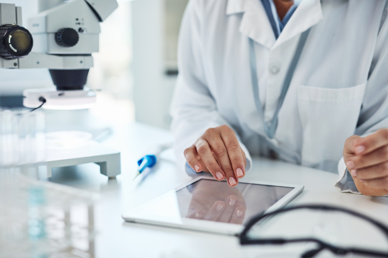 Researcher working on ipad in lab environment